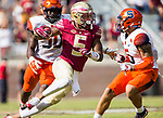 Florida State wide receiver Ermon Lane cuts between Syracuse linebacker Parris Bennett, left, and defensive back Rodney Williams in the second half of an NCAA college football game in Tallahassee, Fla., Saturday, Nov. 4, 2017. Florida State defeated Syracuse 27-24. (AP Photo/Mark Wallheiser)