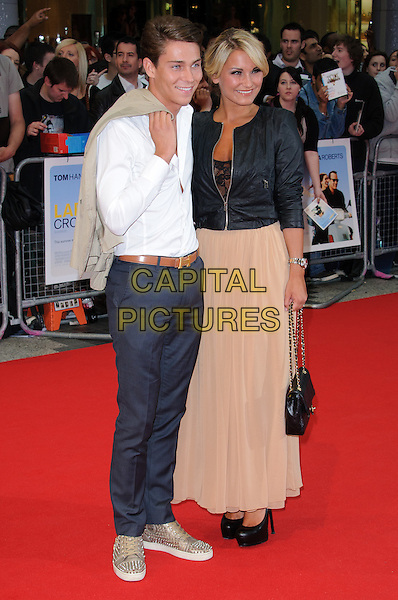 Joey Essex & Sam Faiers.'Larry Crowne' world film premiere, Vue cinema, Westfield, Shepherds Bush, London, England 6th June 2011.full length black leather jacket beige nude maxi skirt couple bag white shirt  grey gray trousers brown belt TOWIE chanel bag trainers gold .CAP/CJ.©Chris Joseph/Capital Pictures.
