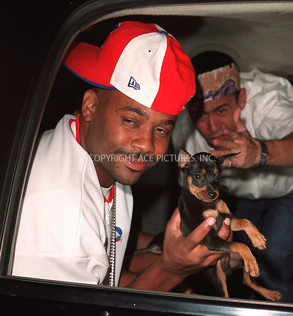 Rap mogul Damon Dash with dog Rocco arriving at the party celebration of the first anniversary of his club Man Ray. New York, July 10, 2002. Please byline: Alecsey Boldeskul/NY Photo Press.   ..*PAY-PER-USE*      ....NY Photo Press:  ..phone (646) 267-6913;   ..e-mail: info@nyphotopress.com