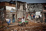 Iqbal, seats in front of his house completely destroied, waiting to move to one of the vertical slums in Mumbai suburb, 26 November, 2010....