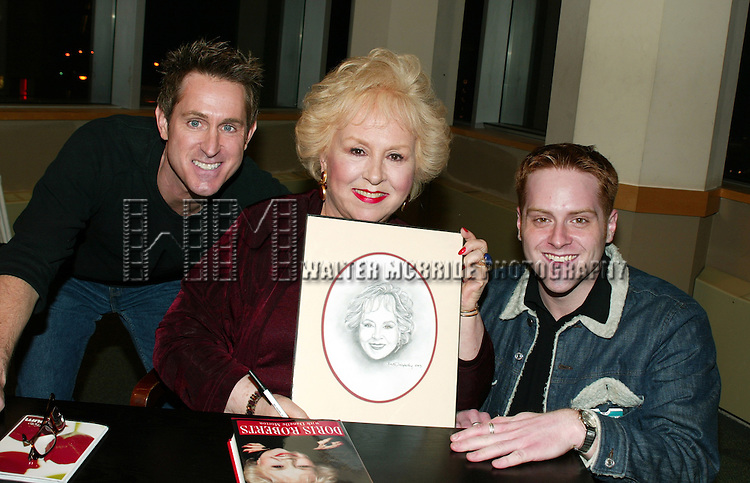 DORIS ROBERTS <br /> ( With two of her fans who gave her a drawing <br /> by Keith Dougherty )<br /> Promoting her new book, ARE YOU HUNGRY, DEAR ?<br /> at a book signing held at Barnes &amp; Noble,<br /> New York City.<br /> April 14, 2003