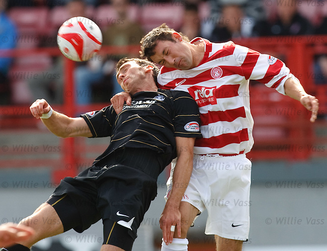 Martin Canning makes a strong clearance from Lee Miller