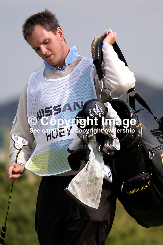 Johnny Foster, Ballyclare, N Ireland, golf caddy, amateur golfer. Taken at Nissan Irish Open, Portmarnock Golf Club, Ireland, in July 2003. Ref: 200307232708...Copyright Image from Victor Patterson, 54 Dorchester Park, Belfast, UK, BT9 6RJ..Tel: +44 28 9066 1296.Mob: +44 7802 353836.Voicemail +44 20 8816 7153.Skype: victorpattersonbelfast.Email: victorpatterson@mac.com.Email: victorpatterson@ireland.com (back-up)..IMPORTANT: If you wish to use this image or any other of my images please go to www.victorpatterson.com and click on the Terms & Conditions. Then contact me by email or phone with the reference number(s) of the image(s) concerned.