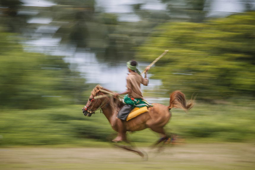 A Pasola warrior accelerate his horse before throwing the spear at the enemy forces at the event in Waiha, Kodi. Pasola is an ancient tradition from the Indonesian island of Sumba. Categorized as both extreme traditional sport and ritual, Pasola is an annual mock horse warfare performed in response to the harvesting season. In the battelfield, the Pasola warriors use blunt spears as their weapon. However, fatal accident still do occurs.