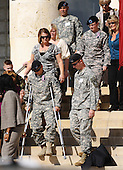 Fort Hood, TX - November 10, 2009 -- A soldier wounded in the shooting arrives at the memorial service for the 12 soldiers and one civilian killed at Fort Hood U.S Army Post near Killeen, Texas, USA 10 November 2009. Army Major Malik Nadal Hasan reportedly shot and killed 13 people, 12 soldiers and one civilian, and wounded 30 others in a rampage 05 November at the base's Soldier Readiness Center where deploying and returning soldiers undergo medical screenings.  .Credit: Tannen Maury / Pool via CNP