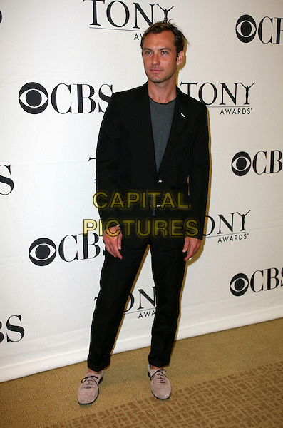 JUDE LAW .Attending the 2010 Tony Awards Meet the Nominees Press Reception on May 5, 2010 in New York City, New York, NY, USA, 5th May 2010..full length black suit grey gray t-shirt jacket suede beige desert shoes lace-up.CAP/ADM/PZ.©Paul Zimmerman/AdMedia/Capital Pictures.