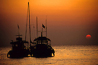 Fishing boats together at sunset, Koh Samet Island, Thailand.