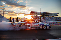 Sep 2, 2016; Clermont, IN, USA; The sun sets as NHRA pro stock driver Jason Line does a burnout during qualifying for the US Nationals at Lucas Oil Raceway. Mandatory Credit: Mark J. Rebilas-USA TODAY Sports