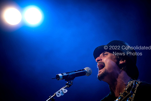 Ramstein AFB, Germany - December 16, 2008 -- Grammy award winning musician Kid Rock  performs for service members during the 2008 USO Holiday Tour stop at Ramstein Air Force Base, Germany on Tuesday, December 16, 2008. Tour host United States Navy Admiral Mike Mullen, chairman of the Joint Chiefs of Staff and his wife Deborah were joined by, along with Rock, comedians John Bowman, Lewis Black and Kathleen Madigan; actress Tichina Arnold and American Idol contestant and country musician Kellie Pickler on the tour bringing joy to service members and their families stationed overseas. .Credit: Chad J. McNeeley - DoD via CNP