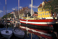 Copenhagen, Denmark, Scandinavia, Sjaelland, Europe, Boats and buildings along a canal in the scenic city of Copenhagen.