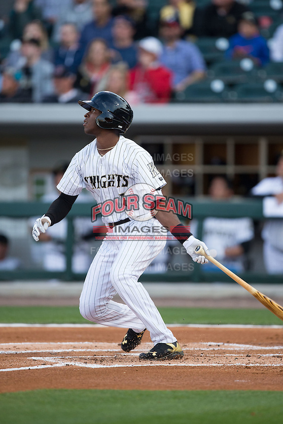 Tim Anderson (7) of the Charlotte Knights follows through on his swing against the Durham Bulls at BB&T BallPark on April 14, 2016 in Charlotte, North Carolina.  The Bulls defeated the Knights 2-0.  (Brian Westerholt/Four Seam Images)