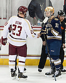 Patrick Brown (BC - 23), Jeff Costello (ND - 11), Dave Hansen - The visiting University of Notre Dame Fighting Irish defeated the Boston College Eagles 7-2 on Friday, March 14, 2014, in the first game of their Hockey East quarterfinals matchup at Kelley Rink in Conte Forum in Chestnut Hill, Massachusetts.