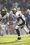 Culver City, CA 09/17/10 - Brock Dale (Peninsula #7) and Logan Okuda (Peninsula #25) in action during the Peninsula Panthers-Culver City Centaurs varsity football game at Culver City High School.