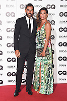 LONDON, UK. September 05, 2018: Robert Pires & wife at the GQ Men of the Year Awards 2018 at the Tate Modern, London