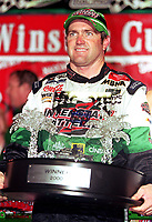 NASCAR driver Bobby Labonte holds his trophy in Victory Lane after winning the rain-shortened Pepsi Southern 500 at Darlington, SC on Sunday, 9/3/00. (Photo by Brian Cleary)