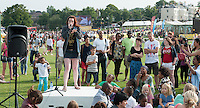 "Grace Savage, beatboxer (www.facebook.com/GraciousBeatbox), at ""Showtime"", part of the London 2012 Festival of Arts to celebrate the London Olympics.  A family fun spectacle including dance, painting, music, acrobatics and some large mobile dynosaurs walking amongst the crowd.  On Blackheath Common, Saturday August 4th and funded by the Mayor of London and Arts Council England."