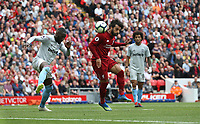 Liverpool's Mohamed Salah with a header towards goal under pressure from West Ham United's Arthur Masuaku<br /> <br /> Photographer Rob Newell/CameraSport<br /> <br /> The Premier League - Liverpool v West Ham United - Sunday August 12th 2018 - Anfield - Liverpool<br /> <br /> World Copyright &copy; 2018 CameraSport. All rights reserved. 43 Linden Ave. Countesthorpe. Leicester. England. LE8 5PG - Tel: +44 (0) 116 277 4147 - admin@camerasport.com - www.camerasport.com