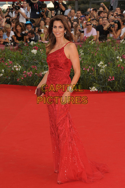 Cindy Crawford (wearing Roberto Cavalli).'The Ides of March' screening.68th Venice International Film Festival, Italy 31st August 2011.full length red one shoulder sequined sequins embroidered dress brown clutch bag side.CAP/PL.©Phil Loftus/Capital Pictures.