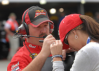 Mar 31, 2007; Martinsville, VA, USA; Tony Eury Jr , crew chief for Nascar Nextel Cup Series driver Dale Earnhardt Jr (8) signs an autograph for a fan during practice for the Goody's Cool Orange 500 at Martinsville Speedway. Martinsville marks the second race for the new car of tomorrow. Mandatory Credit: Mark J. Rebilas