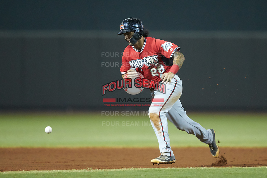 Eddie Silva (28) of the Carolina Mudcats avoids the baseball as he hustles towards third base against the Winston-Salem Dash at BB&T Ballpark on June 1, 2019 in Winston-Salem, North Carolina. The Dash defeated the Mudcats 5-4 in game two of a double header. (Brian Westerholt/Four Seam Images)