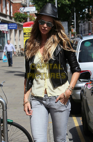 ELLE MACPHERSON.Seen out and about shopping in London, England, UK, June 1st 2011..half length ray bans sunglasses aviators hat black leather jacket grey gray jeans  yellow shirt gold bangles bracelets .CAP/HIL.©John Hillcoat/Capital Pictures.