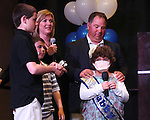 Surrounded by her family, from left, Garrett, Gunner, mom Heather and dad Buddy, Gabby Gouldsmith, 8, answers questions during the Make-A-Wish Foundation Waffles & Wishes event at the Atlantis Casino Resort, in Reno, Nev., on Tuesday, March 27, 2012. Gouldsmith, who suffers from an auto-immune deficiency disorder, received a bedroom makeover from the organization. .Photo by Cathleen Allison