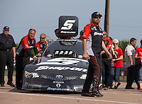 Apr. 28, 2013; Baytown, TX, USA: NHRA funny car driver Cruz Pedregon with crew after winning the Spring Nationals at Royal Purple Raceway. Mandatory Credit: Mark J. Rebilas-