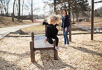 NWA Democrat-Gazette/CHARLIE KAIJO Olivia Minteer of Centerton, 3, plays on the outdoor gym, Thursday, February 15, 2018 along the Razorback Greenway in Bentonville. <br />