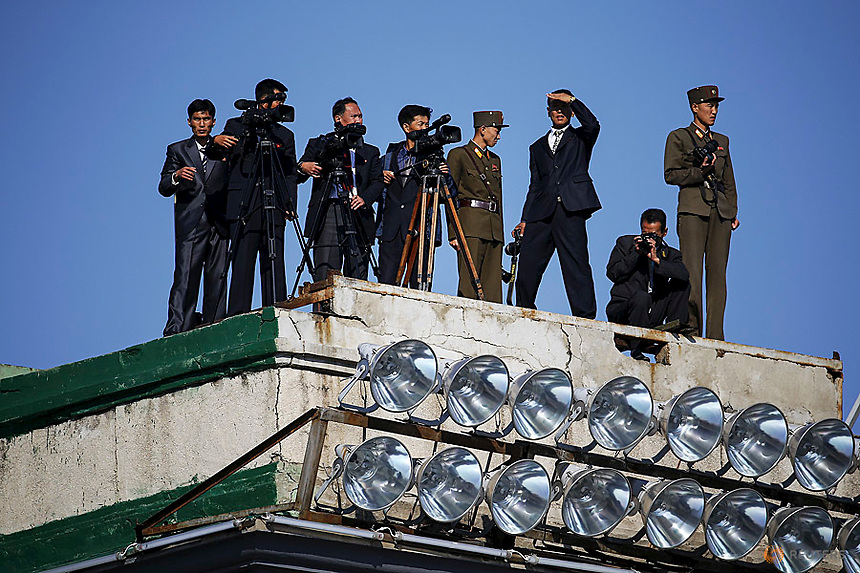 Cameramen expect arrival of North Korean leader Kim Jong Un at the beginning of the parade celebrating the 70th anniversary of the founding of the ruling Workers' Party of Korea, in Pyongyang October 10, 2015. Isolated North Korea marked the 70th anniversary of its ruling Workers' Party on Saturday with a massive military parade overseen by leader Kim Jong Un, who said his country was ready to fight any war waged by the United States.   REUTERS/Damir Sagolj  - RTS3VR2