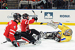 Shawn Matheson (10) tries to deflect the puck over the Swedish goalie during 2010 Paralympic Games sledge hockey action at UBC Thunderbird Arena in Vancouver.Credit: CPC/HC/Matthew Manor.