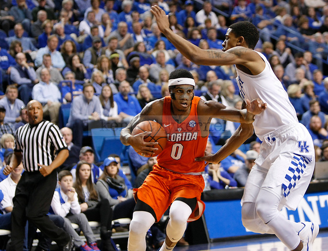 Florida guard Kasey Hill (0) drives the basketball on UK forward Charles Matthews (4) during the UK Men's Basketball vs. Florida Gators game at Rupp Arena. Saturday, February 6, 2016 in Lexington, Ky. UK defeated Florida 80 - 61