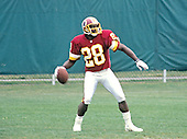 Washington Redskins cornerback Darrell Green (28) prepares to throw the football to another player during Washington Redskins training camp at Dickinson College in Carlisle, Pennsylvania on July 26, 1993.<br /> Credit: Ron Sachs / CNP
