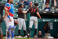 Indianapolis Indians Logan Hill (35) fist bumps Will Craig (left) after hitting a home run during an International League game against the Buffalo Bisons on June 20, 2019 at Sahlen Field in Buffalo, New York.  Buffalo defeated Indianapolis 11-8  (Mike Janes/Four Seam Images)