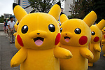 "Pikachus greet to the camera during parade at the ""1000 Pikachu Outbreak! at Yokohama Minatomirai"" on August 09, 2014. 1000 Pikachu performed at different areas of Minatomirai in Yokohama during the summer vacation event from August 9 to 17.  (Photo by Rodrigo Reyes Marin/AFLO)"