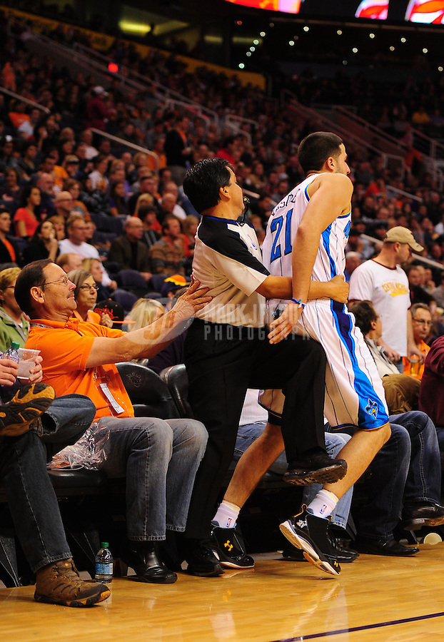 Dec. 26, 2011; Phoenix, AZ, USA; New Orleans Hornets guard Greivis Vasquez bumps into NBA referee Tommy Nunez during the game against the Phoenix Suns at the US Airways Center. The Hornets defeated the Suns 85-84. Mandatory Credit: Mark J. Rebilas-USA TODAY Sports