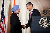Washington, DC - November 24, 2009 -- Manmohan Singh, left, India's prime minister, shakes hands with United States President Barack Obama during an arrival ceremony in the East Room of the White House in Washington, D.C., U.S., on Tuesday, November 24, 2009.  .Credit: Joshua Roberts - Pool via CNP