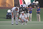 Ian Poulter laughs with the match referee after his ball moved on the green during the final round of the Dubai World Championship on the Earth Course at the Jumeirah Golf Estate, Dubai..Picture Fran Caffrey/www.golffile.ie.