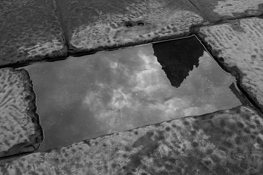 Reflection of the Angkor Wat Towers in the pavement, Cambodia