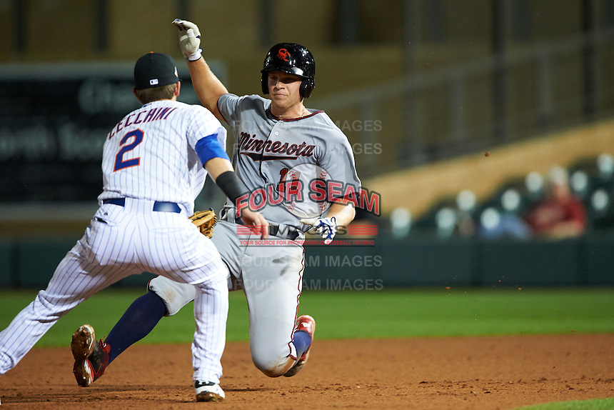 Scottsdale Scorpions catcher Stuart Turner (11) slides into the tag by shortstop Gavin Cecchini (2) while running the bases during an Arizona Fall League game against the Salt River Rafters on October 13, 2015 at Salt River Fields at Talking Stick in Scottsdale, Arizona.  Salt River defeated Scottsdale 5-3.  (Mike Janes/Four Seam Images)