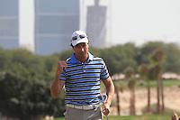 Brett Rumford (AUS) sinks his birdie putt on the 10th green during Friday's Round 3 of the Commercial Bank Qatar Masters 2013 at Doha Golf Club, Doha, Qatar 25th January 2013 .Photo Eoin Clarke/www.golffile.ie