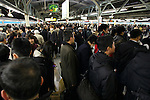 March 17, 2011, Tokyo, Japan - Commuters at Yurakucho Station in Tokyo attempt to make it home before the possible power outage planned in an attempt to conserve electricity. The power grid has been impacted heavily by the recent earthquake and its aftermath. (Photo by AFLO) [0006].