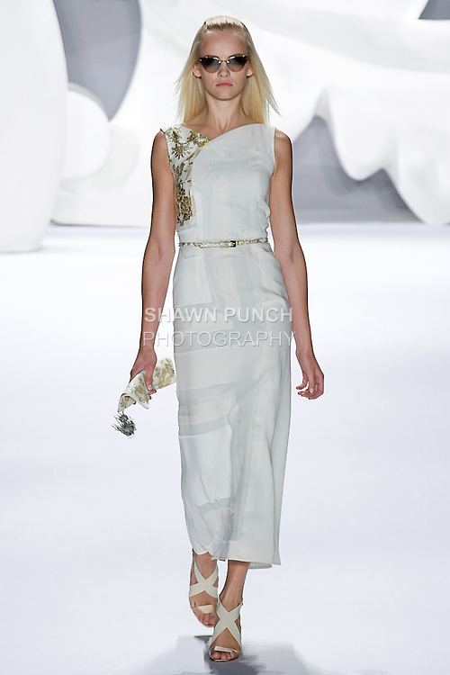 Ginta walks runway in an outfit from the Carolina Herrera Spring 2013 Timeless Influence collection, during Mercedes-Benz Fashion Week Spring 2013 in New York City.