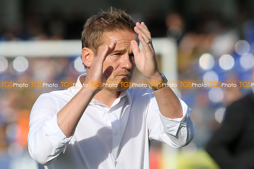 AFC Wimbledon Manager, Neal Ardley, applauds the home fans ahead of kick-off during AFC Wimbledon vs Portsmouth, Sky Bet EFL League 1 Football at the Cherry Red Records Stadium on 13th October 2018