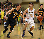 Galena's Scott Geerling and Manogue's James Sandoval compete at Manogue High School in Reno, Nev., on Tuesday, Feb. 11, 2014. Manogue won 66-59.<br /> Photo by Cathleen Allison
