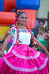 COLORFUL COSTUME ON DANCER AT FESTIVAL