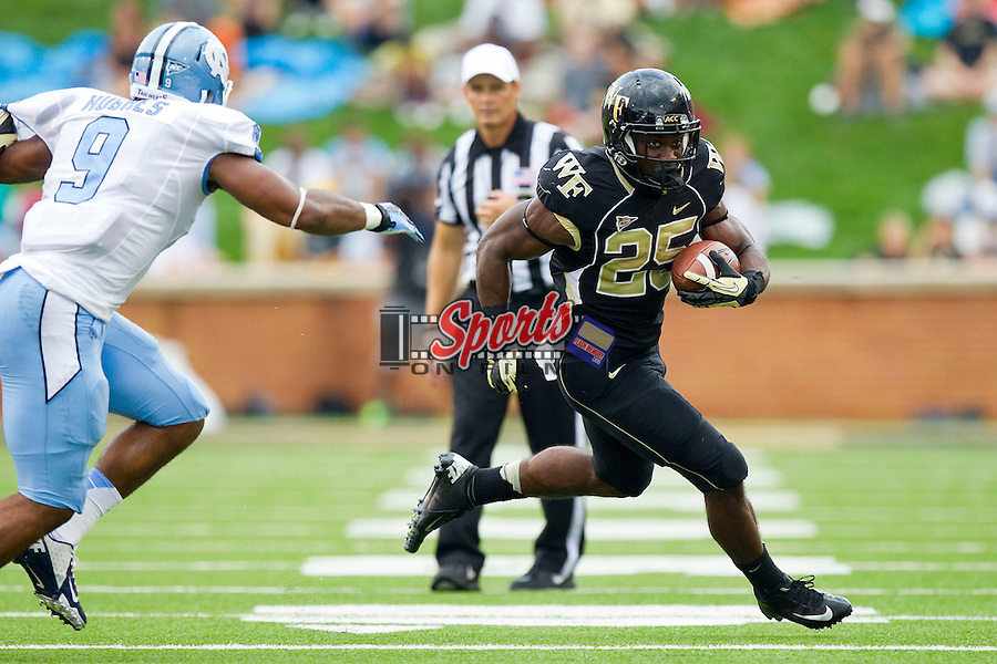 Josh Harris (25) of the Wake Forest Demon Deacons looks for running room during first half action against the North Carolina Tar Heels at BB&T Field on September 8, 2012 in Winston-Salem, North Carolina.  The Demon Deacons defeated the Tar Heels 28-27.  (Brian Westerholt/Sports On Film)