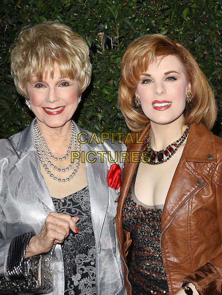 "KAREN KRAMER & KAT KRAMER .""Capitalism: A Love Story"" Los Angeles Premiere held At AMPAS Samuel Goldwyn Theater, Beverly Hills, California, USA..September 15th, 2009.half length silver brown leather jacket necklace black sisters family .CAP/ADM/KB.©Kevan Brooks/AdMedia/Capital Pictures."