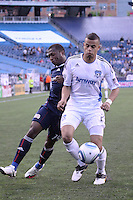 New England Revolution forward Sainey Nyassi (14) and San Jose Earthquakes defender Bobby Burling (2) chase down a ball near the Earthquakes' goal line.  The New England Revolution and San Jose Earthquakes play to a scoreless draw at Gillette Stadium on May 15, 2010
