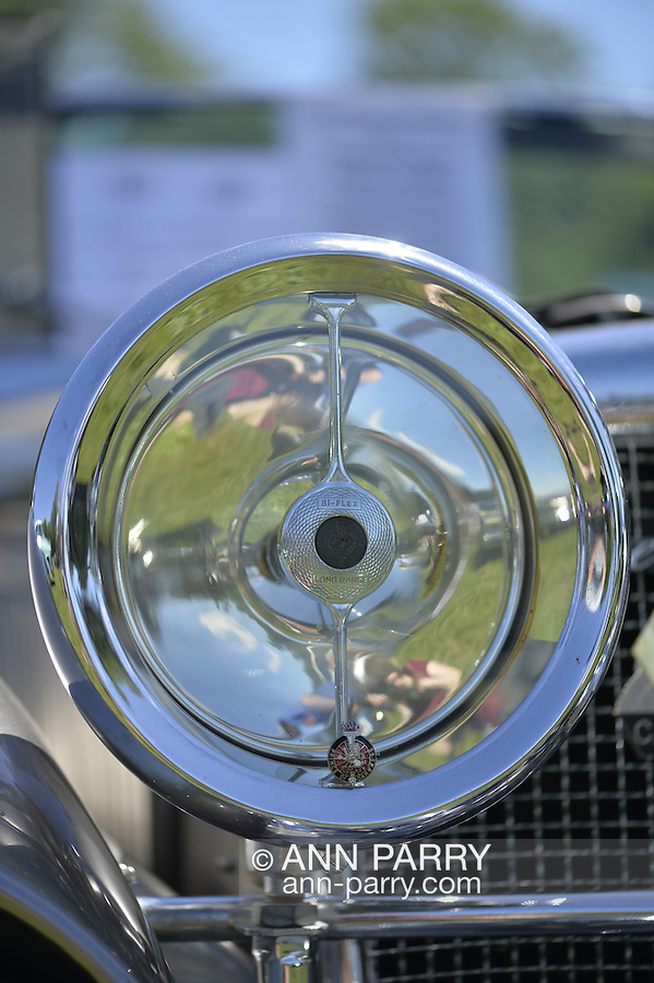 Westbury, New York, USA. June 12, 2016.  Round chrome Bi-flex Long Range Headlamp, with Lucas Prince of Darkness Badge, close up of 1973 Intermeccanica Squire SS-100 Italian luxury classic roadster, owned by Mark Offenberg of Valley Stream, which won 3rd Place Trophy in the foreign car category at the Antique and Collectible Auto Show at the 50th Annual Spring Meet at Old Westbury Gardens, in the Gold Coast of Long Island, and sponsored by Greater New York Region, GNYR, Antique Automobile Club of America, AACA. Car is the 46th of only 50 Intermeccanica's coachbuilt in Turin, Italy. Participating vehicles in the judged show included hundreds of domestic and foreign, antique, classic, collectible, and modern cars.