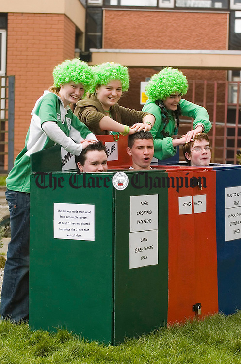 Steven Kerr, Brian O Connell and Tadhg Wilson get binned by Sarah Mc Inerney Ruth Byrne and Ciara Halliday during Green Day in support of the new recycling bins manufactured by the transition years at St Patricks Comprehansive school, Shannon. Photograph by John Kelly.
